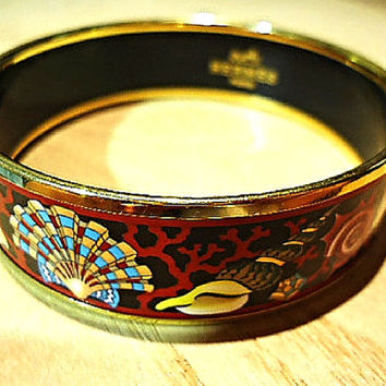Vintage Hermes cloisonne enamel golden thick bangle, bracelet  with ocean, black sea, red, gold, blue colorful shell, red coral design.