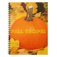 Fall recipes on orange pumpkin on orange leaves spiral note book