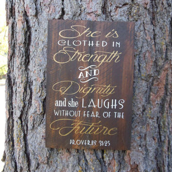 "Joyful Island Creations ""She is clothed in strength and dignity and she laughs without fear of the future"" Proverbs 31:25 wood sign"