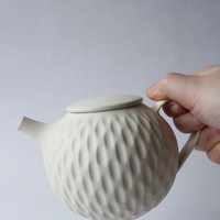 cream white incised teapot