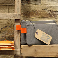 Charcoal grey/orange Mix and match pouches. Travel companions/life organisers/cosmetic bags/toiletry bags.