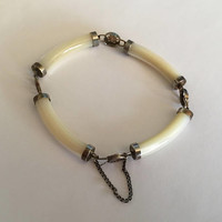 Vintage Chinese Export Jewelry Bracelet with Curved Bar Mother Of Pearl separated with Chinese Good Luck Symbols