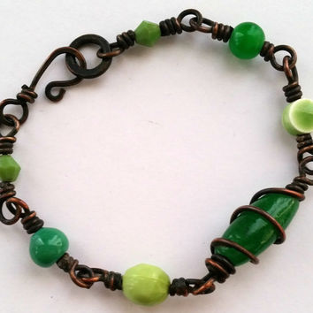 Copper wire wrapped bracelet in shades of green
