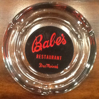 "Vintage collectible souvenir ashtray from ""Babes"" Restaurant in Des Moines, Iowa. Ashtray is glass with cool red and black graphics."