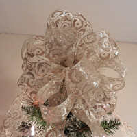 Large Christmas Tree topper bow made with a sheer ribbon with gold glitter swirls