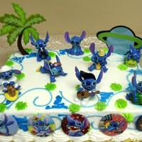"Unique Lilo and Stitch 16 Piece Birthday Cake Topper Set Featuring 8 Stitch Figures, Palm Tree Decorative Piece, Stitch's Rocket Decorative Cake Piece and 6 1"" Stitch Decorative Cake Buttons"