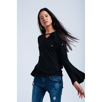 Black sweater with bell sleeves