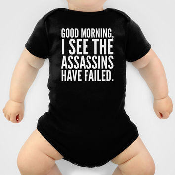 Good morning, I see the assassins have failed. (Black) Baby Clothes by CreativeAngel