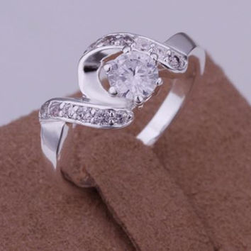 Stunning Silver Plated Ring with CZ Center Stone surrounded with smaller side stones