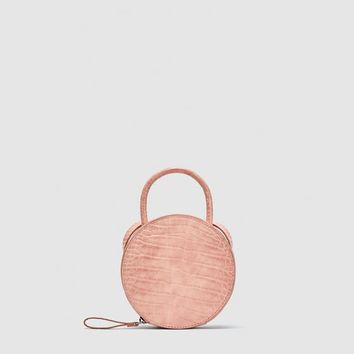 ROUND MINI CROSSBODY BAG DETAILS
