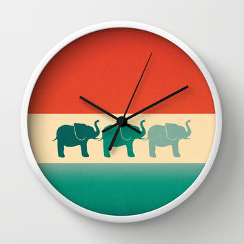 Three Elephants - Burnt orange, cream & teal Wall Clock by Perrin Le Feuvre