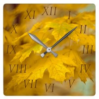 Yellow autumn maple leaves. Roman figures. Square Wall Clock