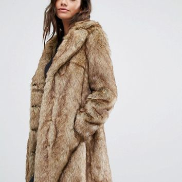 New Look - Manteau mi-long en fausse fourrure at asos.com