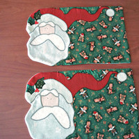 Christmas patchwork placemats with a hand appliqued Santa. Set of two in green and red.