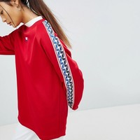 Nike High Neck Sweatshirt In Red With Taped side stripe at asos.com