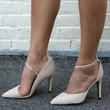 """Eliza"" Diagonal Ankle Strap Almond Toe Pumps - Nude"