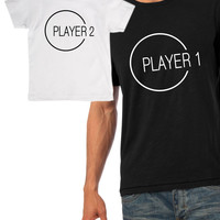 Player 1 and Player 2 matching father and son t-shirts