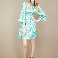green vintage brocade dress with white and metallic silver halo print | shopcuffs.com