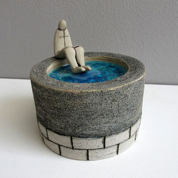 Ceramic decorative plate with small figurine sculpture blue gray table art