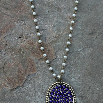 Pink Panache Long Pearl Necklace with Oval Covered in Purple Crystals and Tan Tassel