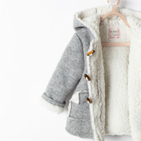 Fleece-lined coat with toggle