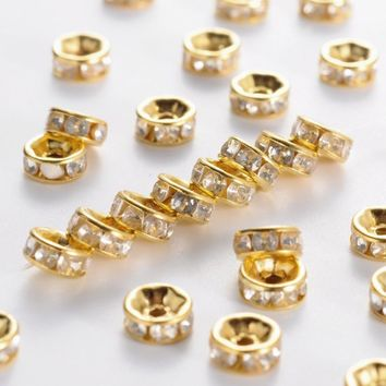 iron rhinestone spacer beads, grade b, straight Lace, rondelle, golden color, clear, size: about 6mm in diameter, 3mm thick,