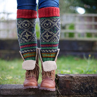 Knee high black knitted socks with Scandinavian ornaments for unisex adults