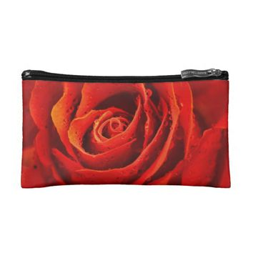 Red rose close-up with morning dew cosmetic bags