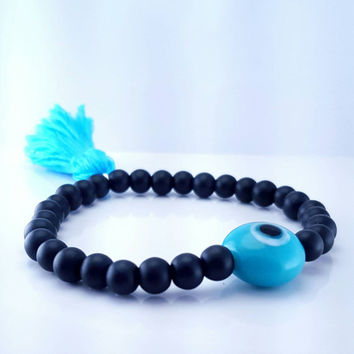 "Beaded ""Eye"" tassel bracelet // matte black semi-precious gemstones // silky bright blue tassel // eye shaped glass bead // boho // gypsy"