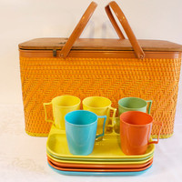 Vintage 1960s Redmon wicker picnic basket with plastic trays and cups