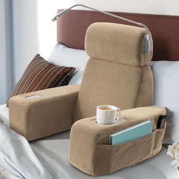 Massaging Sit-Up Pillow with Arms at Brookstone—Buy Now!