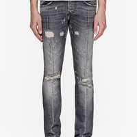 Pierre Balmain Black Super Skinny Distressed Studded Jeans for men | SSENSE