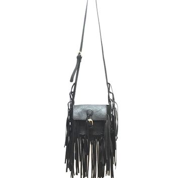 "This small size crossbody bag features a vegan leather with all over layered fringe detail, single buckle strap closure, and adjustable crossbody strap with fringe detailing. Finished with 1 front pocket. Crossbody strap has a 23"" drop."