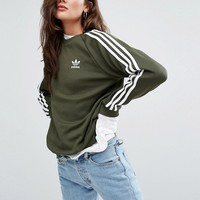 adidas Originals Khaki Three Stripe Boyfriend Sweatshirt at asos.com