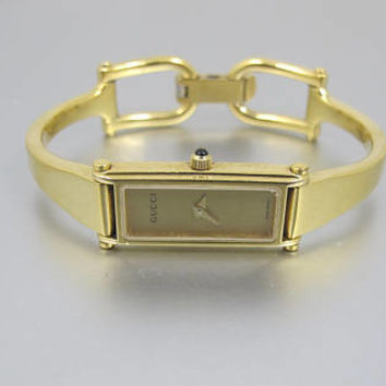 GUCCI Watch. 1500L 18K Yellow Gold Plated. Gucci Tonneau Horsebit Bracelet Watch. Gucci Womens Jewelry