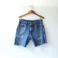 Vintage Wrangler shorts. destressed jean shorts. cut off denim shorts.