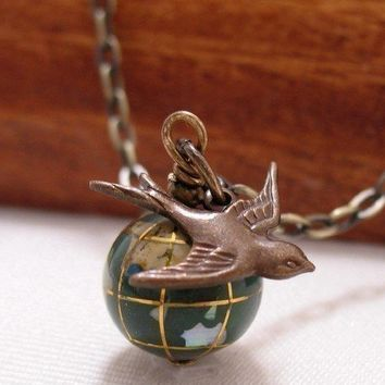 It's A Small World Glass Globe And Swallow Necklace by CuteAbility