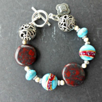 Southwest bracelet. With lamp work glass beads, stone, silver beaded jewelry.