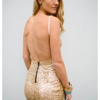 Alana- Feel comfortable and sexy in our backless gold sequin Alana dress