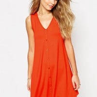 ASOS Sleeveless Swing Dress With Button Front at asos.com