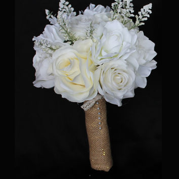 Baby's Breath, Roses and Magnolia's Bridesmaids Bouquet