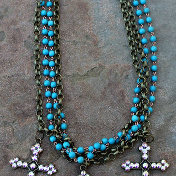 Four Strand Turquoise and Bronze Necklace with Three Crosses Covered in AB Crystals