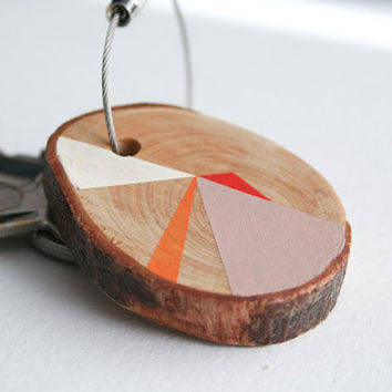 Pine wood keychain with stainless steel cable wire, pink, red, orange and white geometric triangle shapes