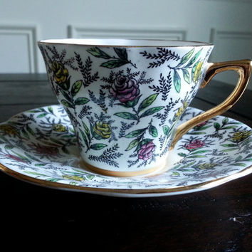 Antique Rosina Chintz tea cup and saucer with pink and yellow roses, English bone china tea set