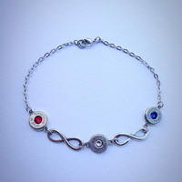 Bullet jewelry. Anklet with bullet casings and infinity charms