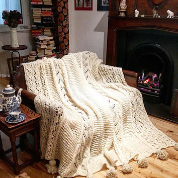 Real unbleached Wool hand knitted blanket with pompons. Rustic, farmhouse decor.Soft,big enough to wrap yourself or cover king size bed.