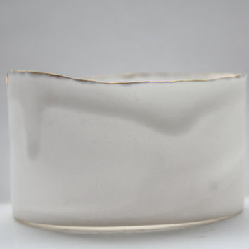 Stoneware fine bone china vessel with real gold finish.