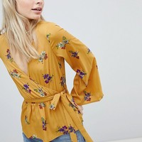 Wednesday's Girl Wrap Blouse With Waist Tie In Floral Bunch Print at asos.com
