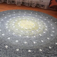 Cute spotted round rug, hand crocheted from a quality wool, 50 to 65 inches in diameter