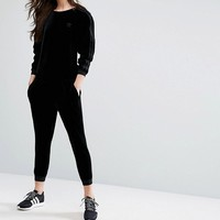 adidas Originals Velvet Long Sleeve Jumpsuit With Tonal Mini Trefoil Logo at asos.com